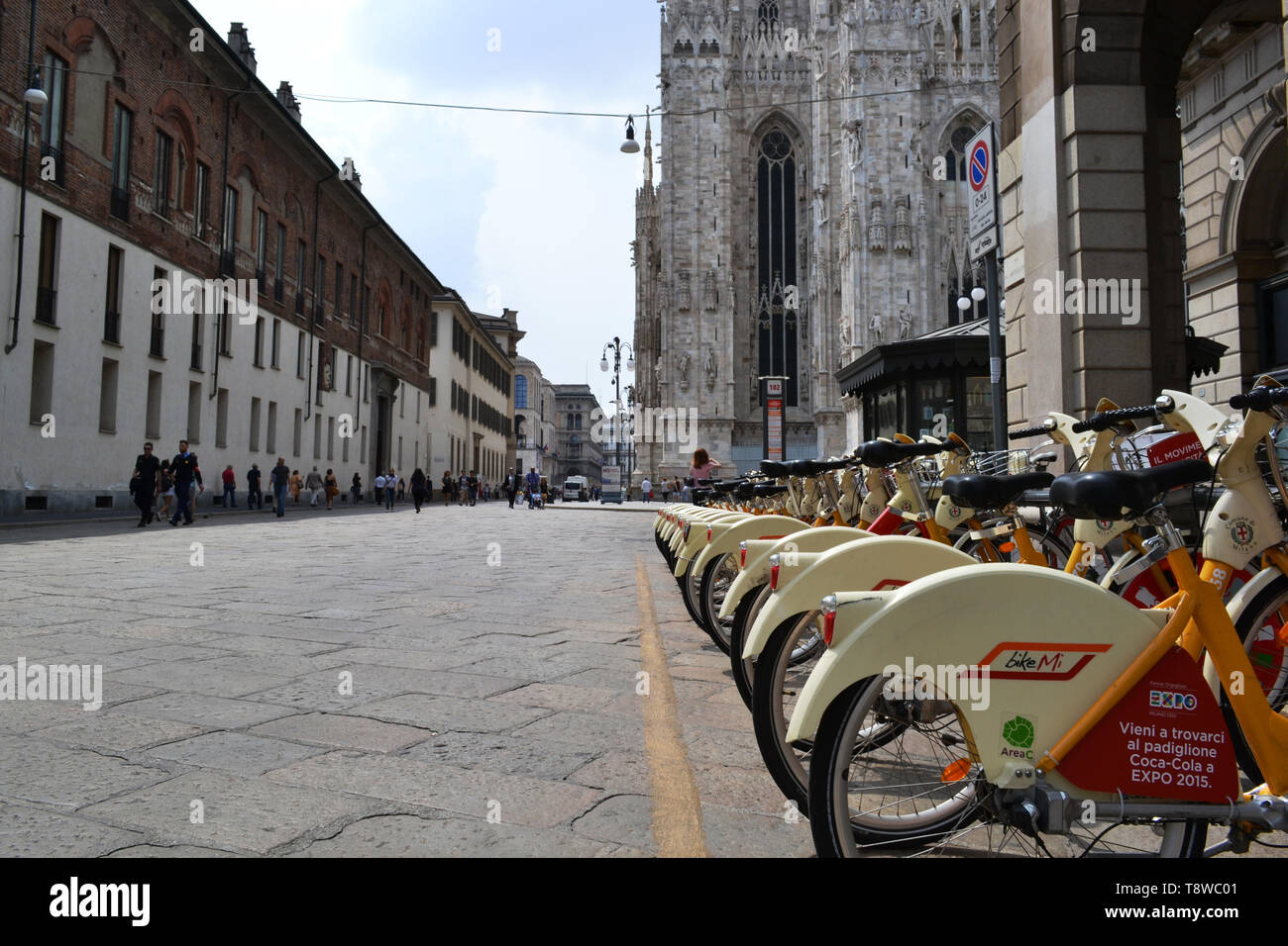 Milan/Italy - June 1, 2015: Rental citybikes branded EXPO Milano 2015 are parked at the station near Duomo of Milan. - Stock Image