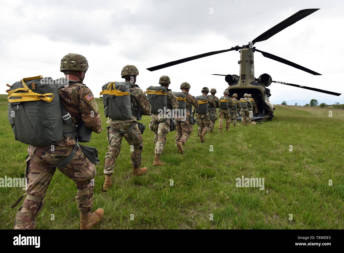 U.S. Army Paratroopers assigned to 54th Brigade Engineer Battalion, 173rd Airborne Brigade, prepare to load from a 12th Combat Aviation Brigade CH-47 Chinook helicopter, at Juliet Drop Zone, Pordenone, Italy, during airborne operation, May 9, 2019. The 173rd Airborne Brigade is the U.S. Army's Contingency Response Force in Europe, capable of projecting ready forces anywhere in the U.S. European, Africa or Central Commands' areas of responsibility. (U.S. Army's Photos by Paolo Bovo) - Stock Image