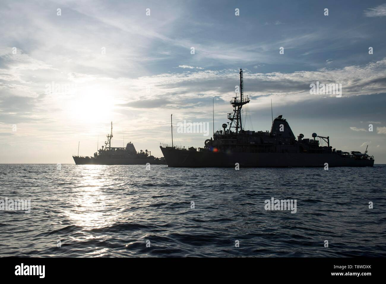 190508-N-SB587-1418 SOUTH CHINA SEA (May 8, 2019) The Avenger-class mine countermeasures ship USS Pioneer (MCM 9) and her sister ship USS Patriot (MCM 7) underway. Both Pioneer and Patriot, part of Mine Countermeasures Squadron 7, are operating in the U.S. 7th Fleet area of operations to enhance interoperability with partners and serve as a ready-response platform for contingency operations. (U.S. Navy photo by Mass Communication Specialist 2nd Class Corbin J. Shea) - Stock Image