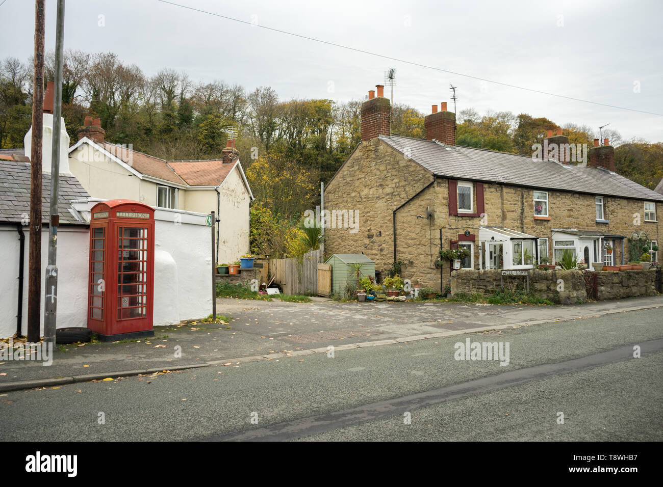 Rural Welsh Village with terraced houses, cottages, in Wales, UK with Red Telephone Box - Stock Image