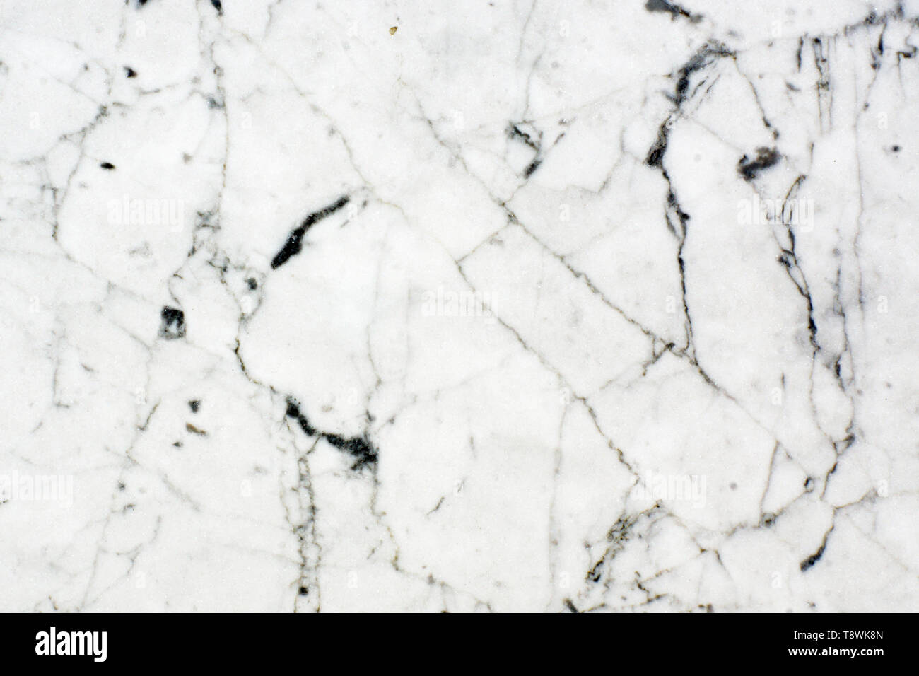White natural stone, dark veined marble texture. - Stock Image