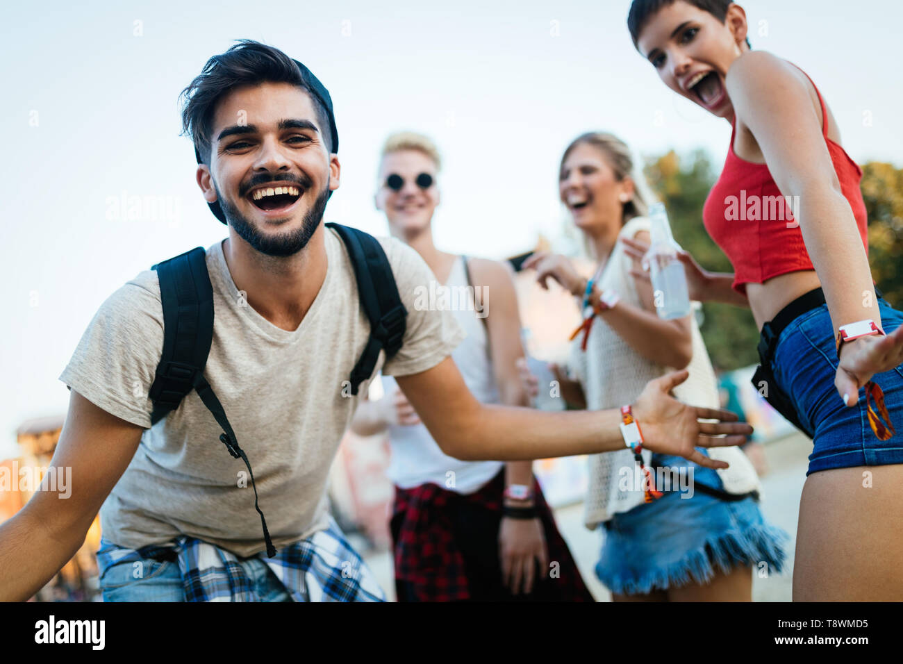 Happy friends having fun at music festival - Stock Image