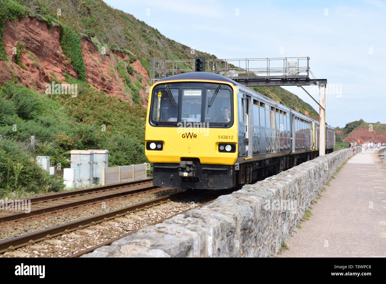 Class 143 'Pacer' approaches Dawlish station in Devon. - Stock Image
