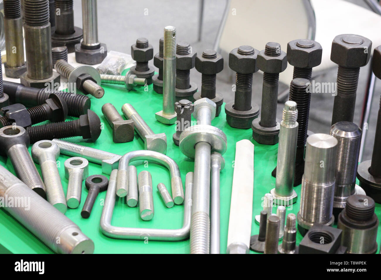 Metal products made at a metallurgical plant. Production of hardware. Stainless fasteners. Many screws, bolts and screws. - Stock Image