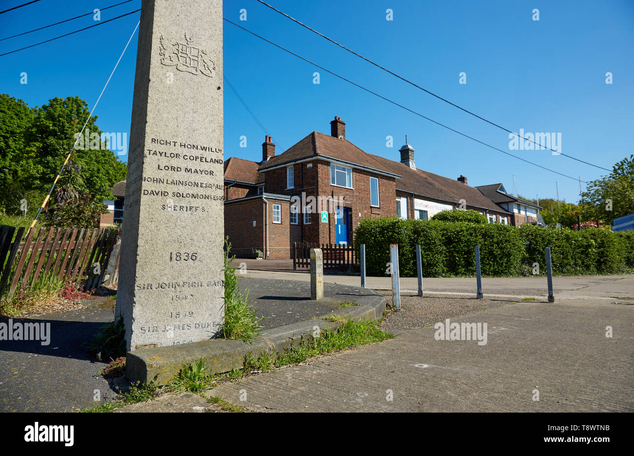 Photograph of the London Stone at Lower Upnor, Kent,UK. With the Arethusa training centre in the background. - Stock Image