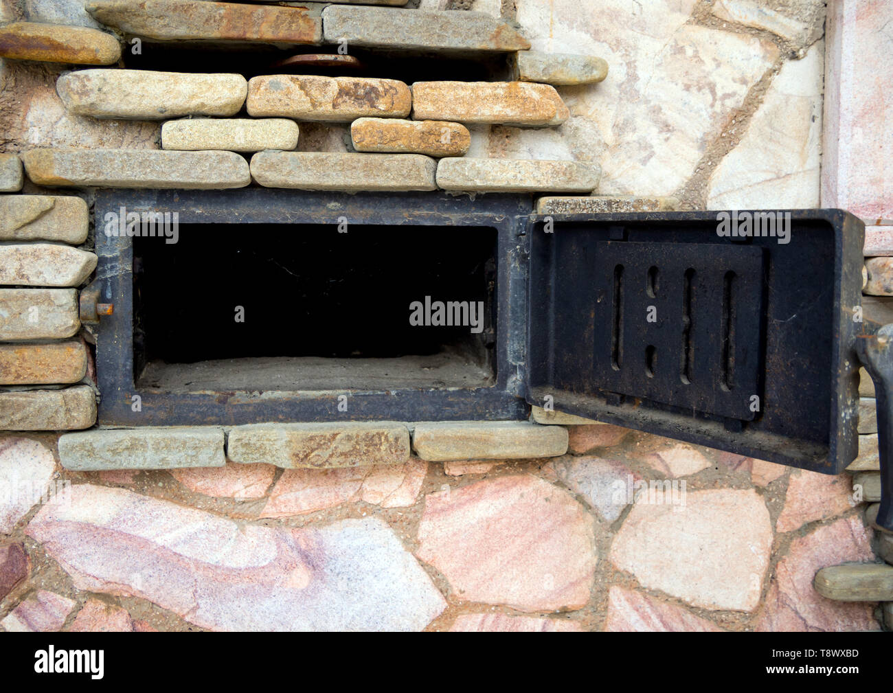 Open forged door blew a large oven - Stock Image