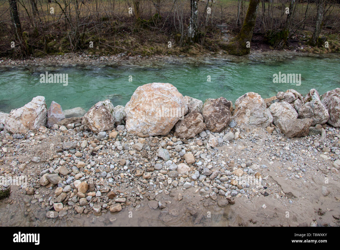 rocks in front of river - Stock Image