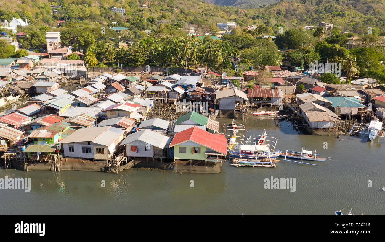Aerial view Coron city with slums and poor district. Palawan.Wooden houses near the water.Poor neighborhoods and slums in the city of Coron aerial view Stock Photo
