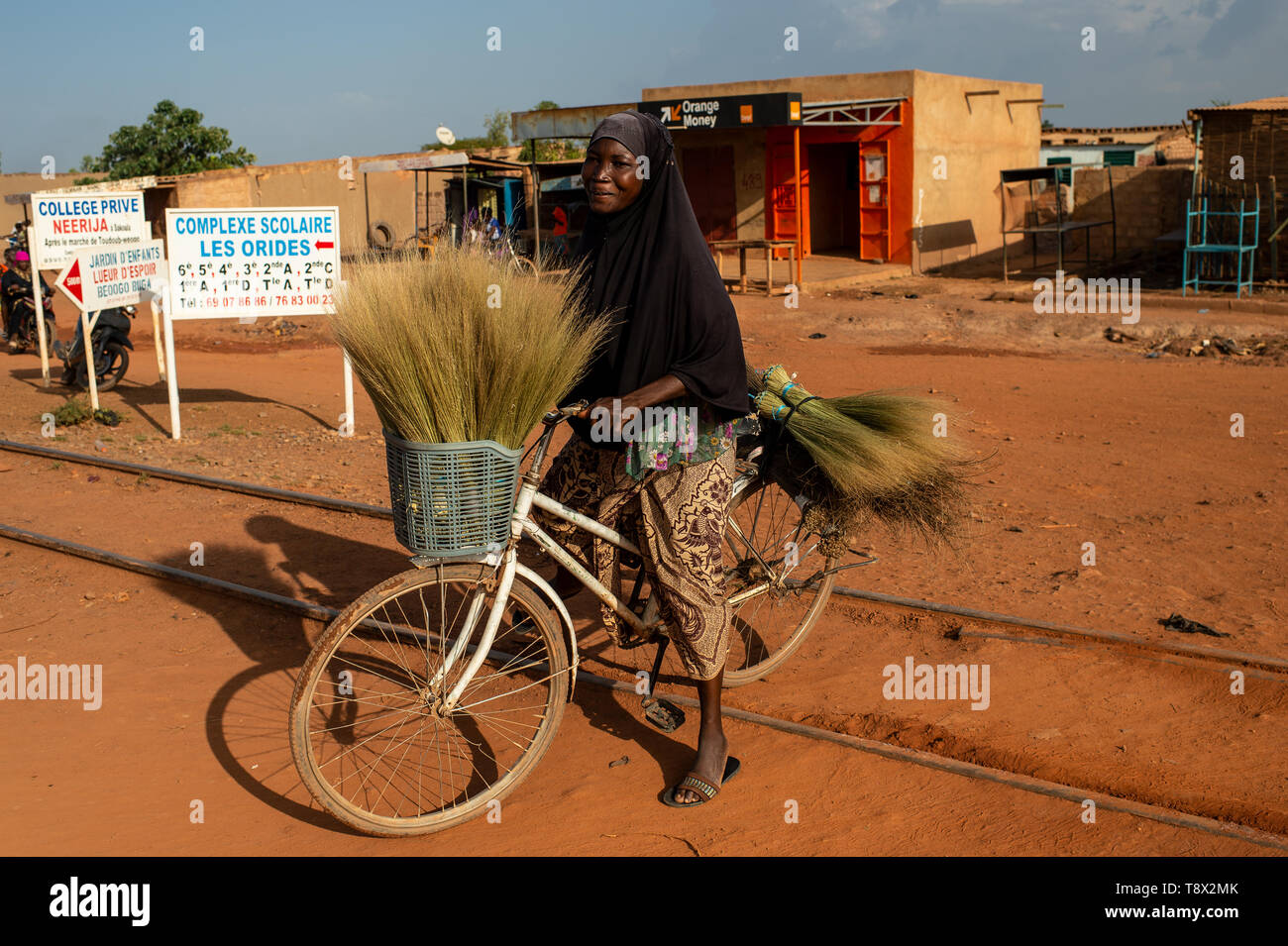 Velated Muslim woman in the streets of Ouagadougou, capital of  Burkina Faso, one of the most poor country of Africa - Stock Image