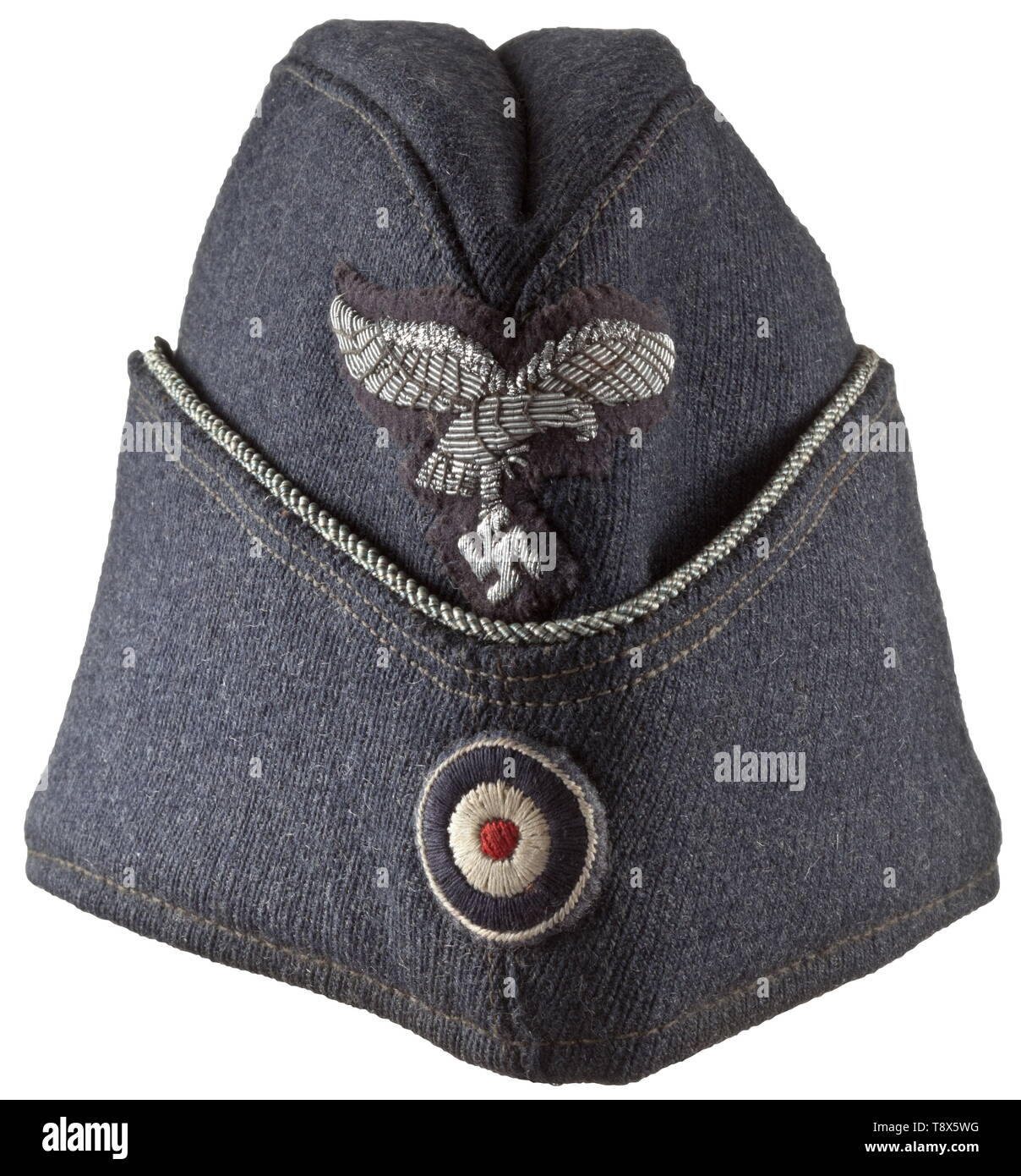 A garrison cap for officers of the Luftwaffe Luftwaffe-blue tricot cloth, officer's braid, steel blue silk liner (maker stamping 'ALMI Uniformen und Mützen Luxemburg 1942 56'), hand-embroidered Luftwaffe eagle, cockade. In a mint state of preservation. historic, historical, Air Force, branch of service, branches of service, armed service, armed services, military, militaria, air forces, object, objects, stills, clipping, clippings, cut out, cut-out, cut-outs, 20th century, Editorial-Use-Only - Stock Image