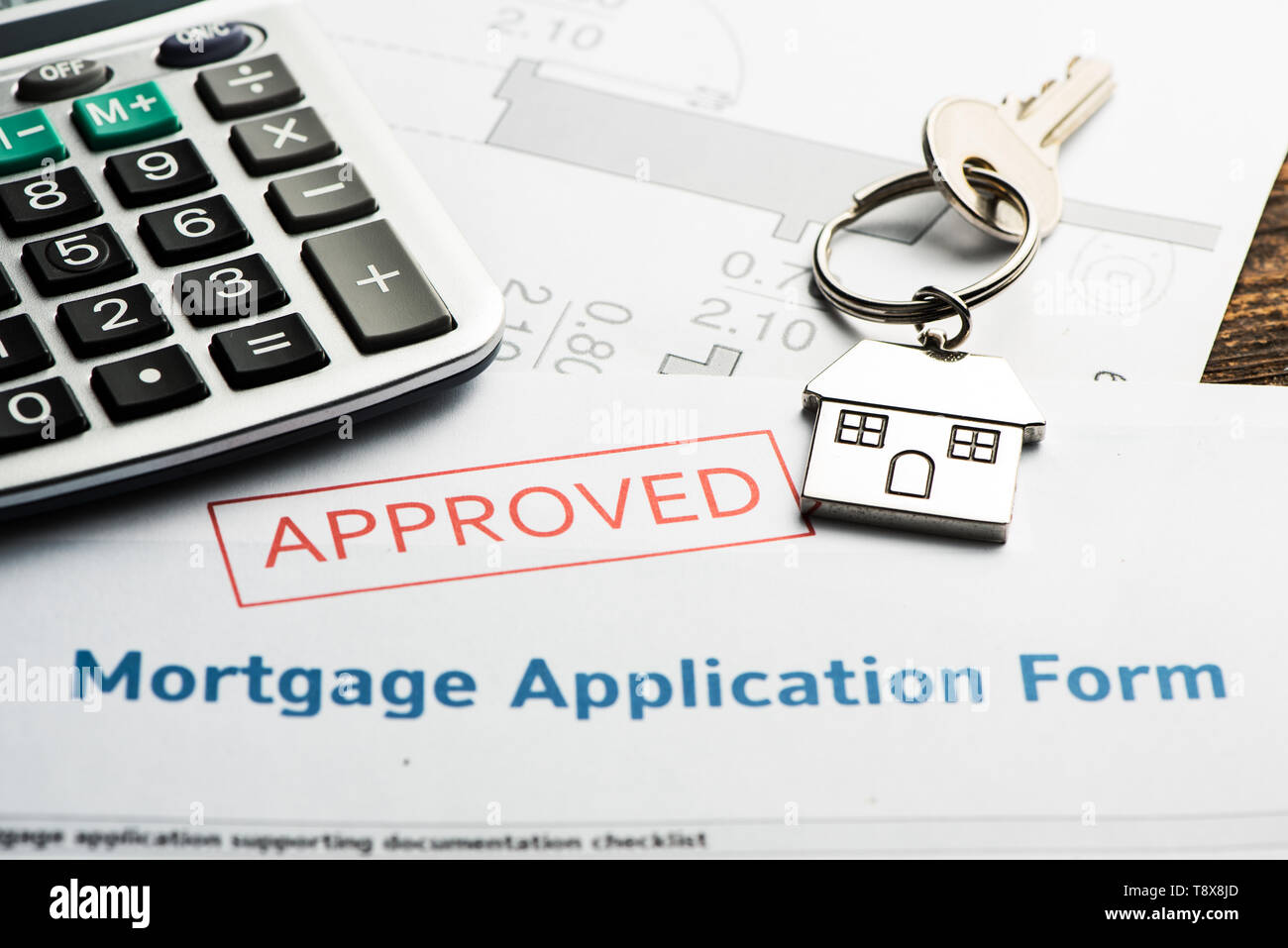 Approved mortgage loan agreement application. Close up Stock Photo