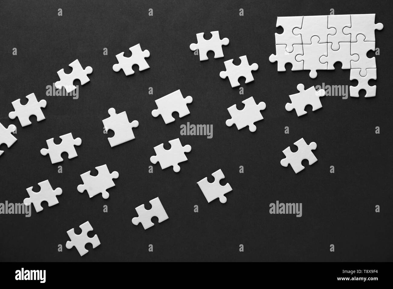 Incomplete jigsaw puzzle on color background - Stock Image