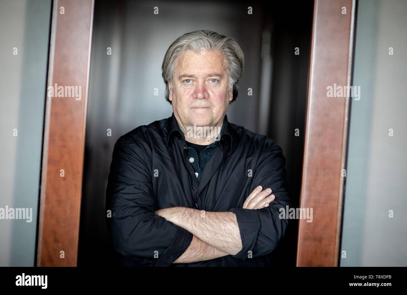 Berlin, Germany. 15th May, 2019. Steve Bannon, former advisor to the US president and US publicist, is standing in a door frame on the edge of an interview with the German press agency dpa. Credit: Kay Nietfeld/dpa/Alamy Live News - Stock Image
