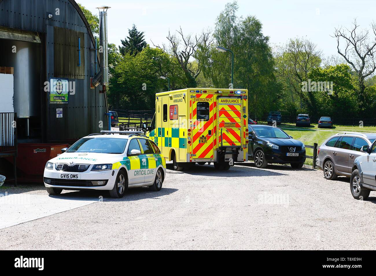 Tenterden, Kent, UK. 15th May, 2019. A Kent Surrey Sussex air ambulance has been dispatched to an incident in the town centre. Medical staff are at scene. The emergency has taken place at the Old Dairy Brewery just off the high street in the town centre. At the scene is a South East Coast ambulance and critical care car. Credit: Paul Lawrenson 2019, Photo Credit: Paul Lawrenson/Alamy Live News Stock Photo