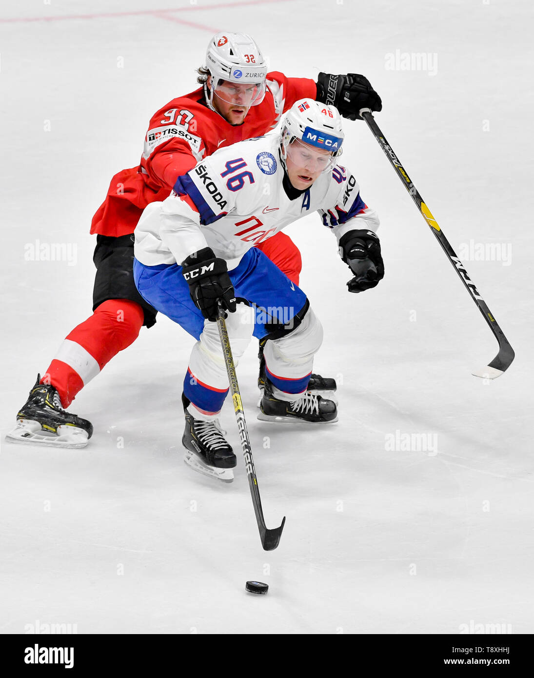 Bratislava, Slovakia. 15th May, 2019. Mathis Olimb (NOR), front, Gaetan Haas (SWE) in action during the match between Switzerland and Norway within the 2019 IIHF World Championship in Bratislava, Slovakia, on May 15, 2019. Credit: Vit Simanek/CTK Photo/Alamy Live News Stock Photo