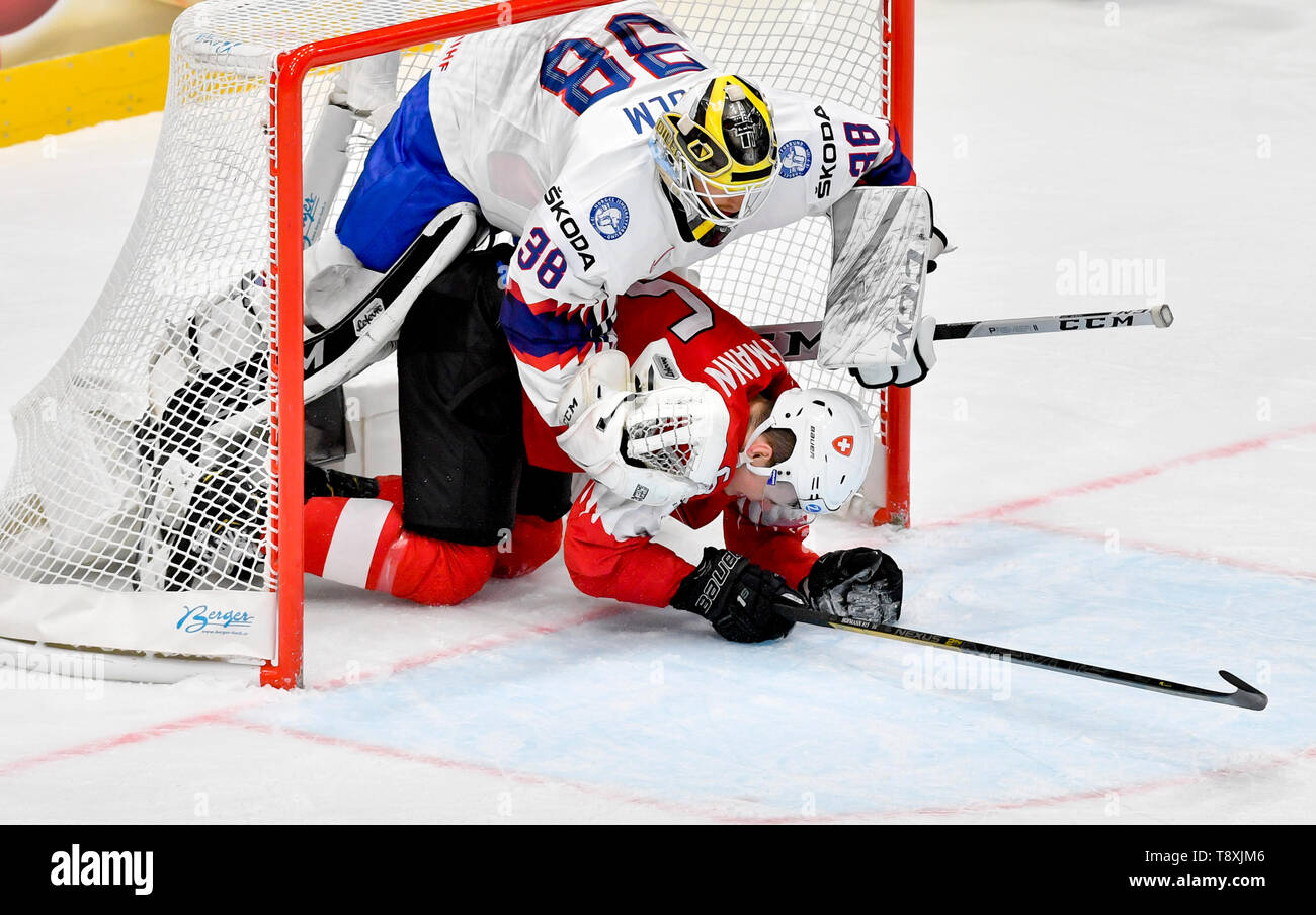 Bratislava, Slovakia. 15th May, 2019. Gregory Hofmann (SWE), in red, and goaltender Henrik Holm (NOR) in action during the match between Switzerland and Norway within the 2019 IIHF World Championship in Bratislava, Slovakia, on May 15, 2019. Credit: Vit Simanek/CTK Photo/Alamy Live News Stock Photo
