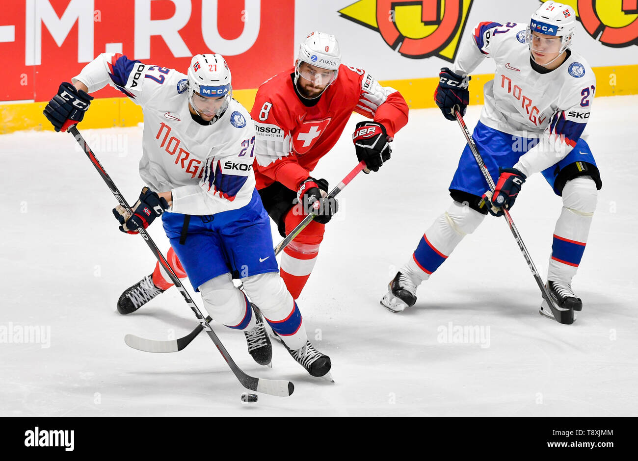 Bratislava, Slovakia. 15th May, 2019. L-R Andreas Martinsen (NOR), Vincent Praplan (CH) and Christian Bull (NOR) in action during the match between Switzerland and Norway within the 2019 IIHF World Championship in Bratislava, Slovakia, on May 15, 2019. Credit: Vit Simanek/CTK Photo/Alamy Live News Stock Photo