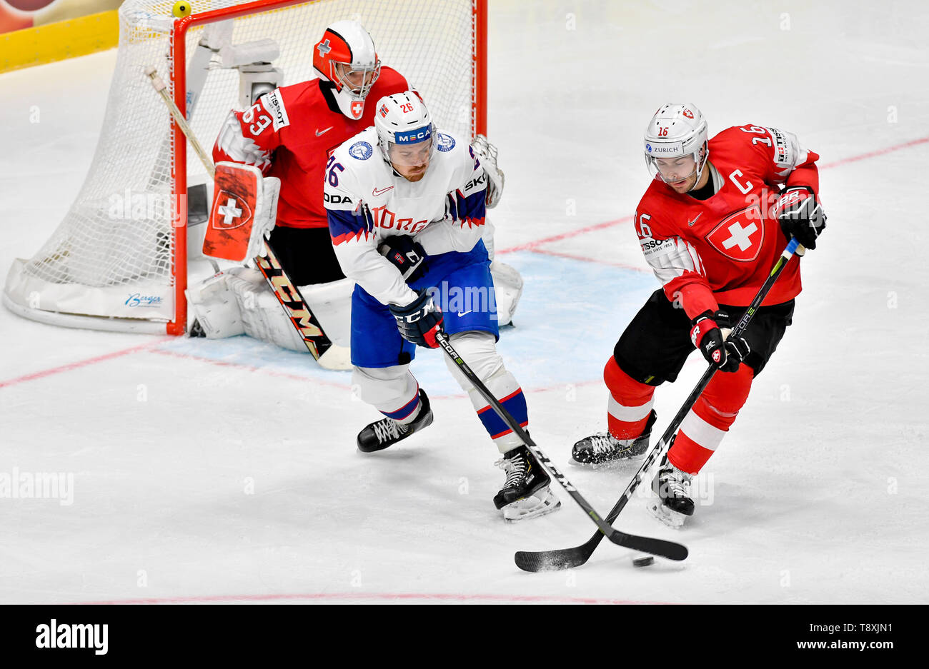 Bratislava, Slovakia. 15th May, 2019. L-R Goaltender Leonardo Genoni (CH), Kristian Forsberg (NOR) and Raphael Diaz (CH) in action during the match between Switzerland and Norway within the 2019 IIHF World Championship in Bratislava, Slovakia, on May 15, 2019. Credit: Vit Simanek/CTK Photo/Alamy Live News Stock Photo