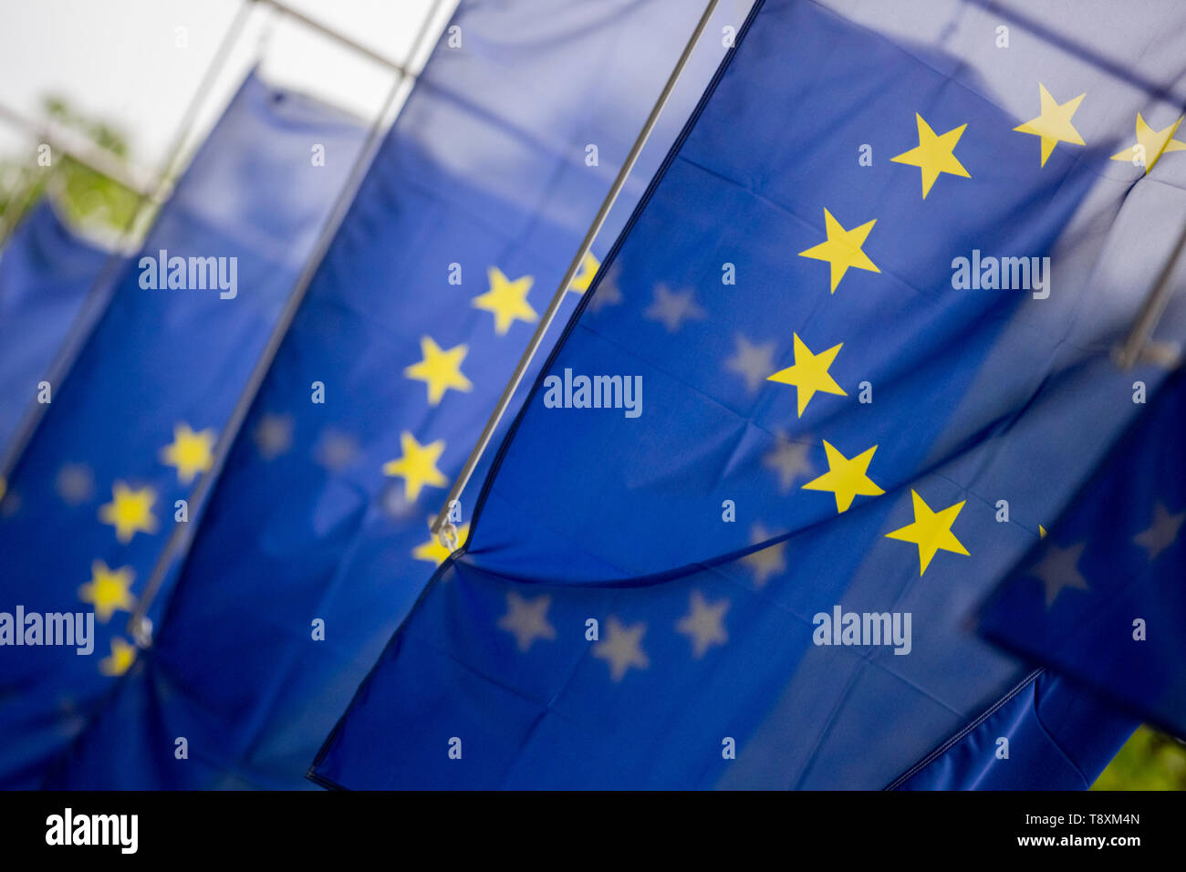 15 May 2019, Berlin: European flags hang at the entrance to the Haus der Deutschen Wirtschaft. Photo: Christoph Soeder/dpa - Stock Image