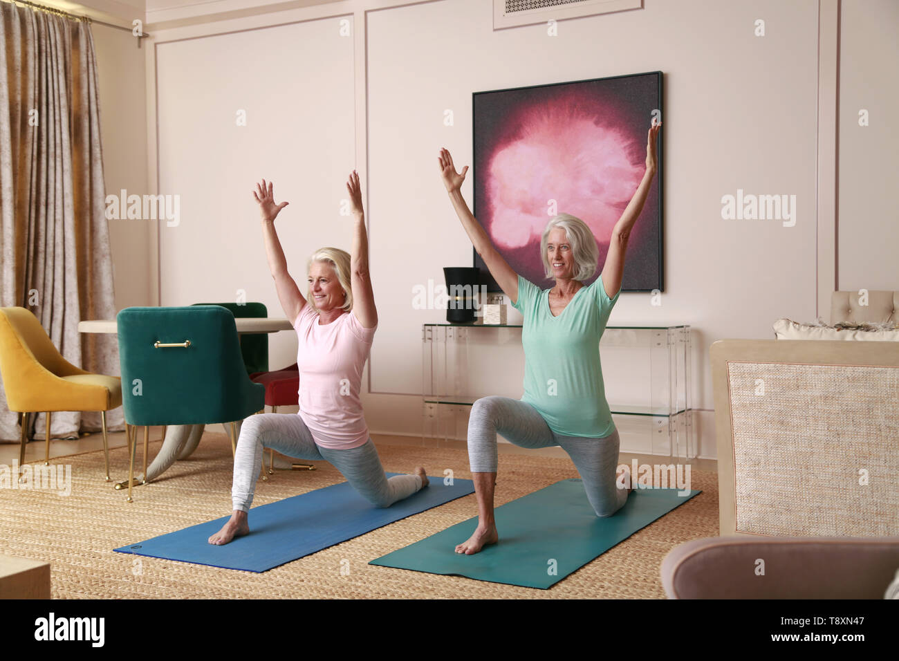 San Diego, CALIFORNIA, USA. 9th Nov, 2018. November 9, 2018 - San Diego, California, USA - Two women do yoga in a home in San Diego. Credit: KC Alfred/ZUMA Wire/Alamy Live News - Stock Image