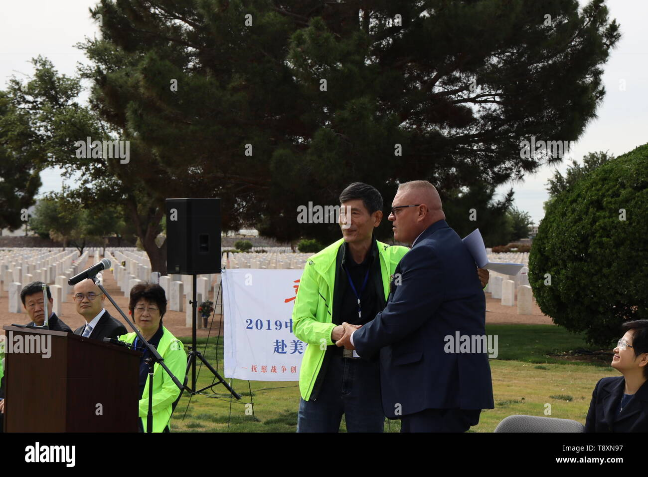 (190515) -- EL PASO (U.S.), May 15, 2019 (Xinhua) -- A formal memorial service is held to commemorate fallen Chinese pilots at the Fort Bliss National Cemetery in El Paso, Texas, the United States, on May 13, 2019. More than seven decades ago, groups of young Chinese came to the United States for military flight trainings against Japanese invasion. Unfortunately, 52 of them were killed during pilot trainings. Now, for the first time in more than half a century, relatives of those killed Chinese cadets made an arduous journey to El Paso, U.S. state of Texas, for belated reunions with their dece - Stock Image