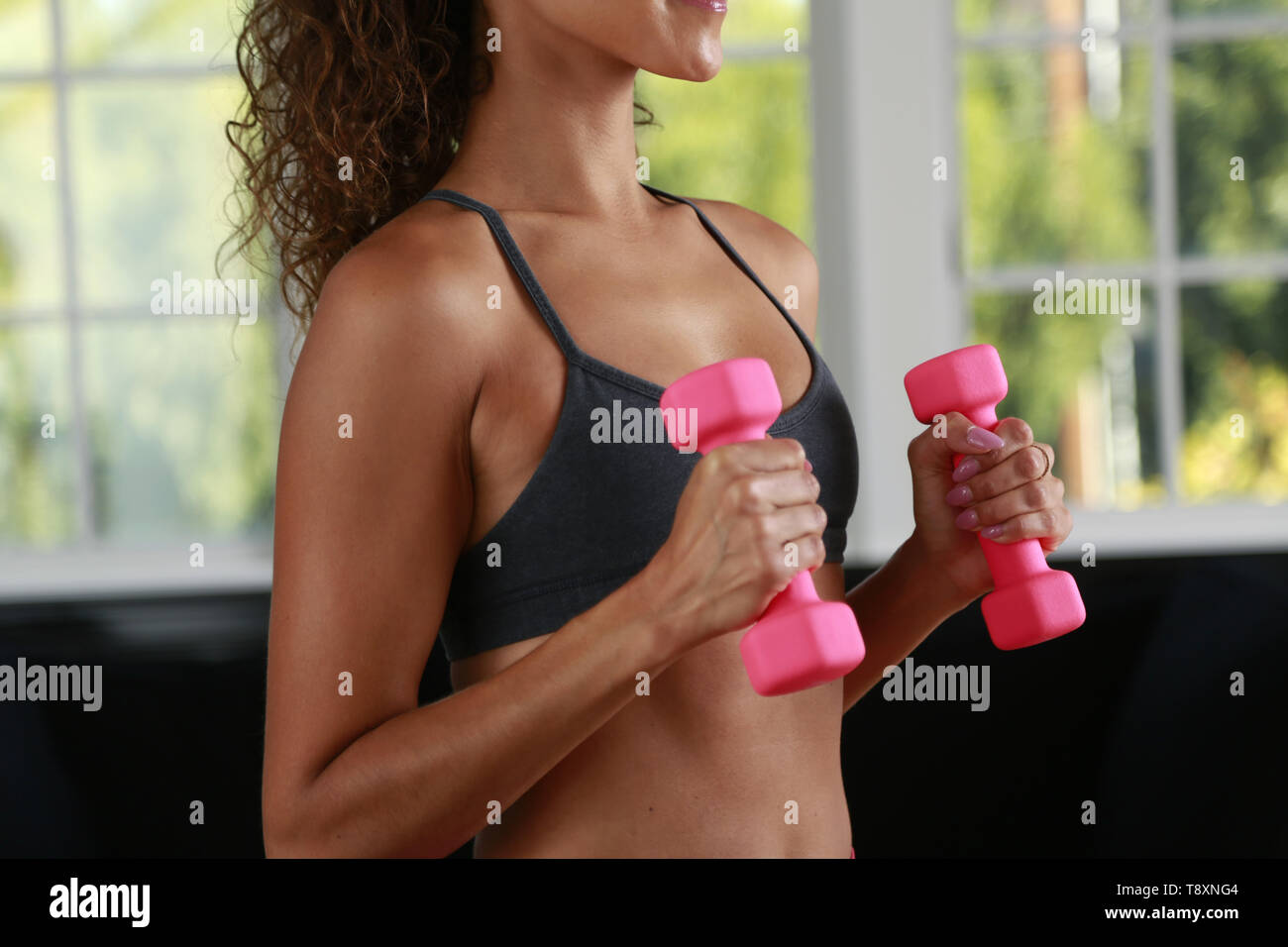 San Diego, CALIFORNIA, USA. 9th Nov, 2018. November 9, 2018 - San Diego, California, USA - A woman does yoga while using weights in a home in San Diego. Credit: KC Alfred/ZUMA Wire/Alamy Live News - Stock Image