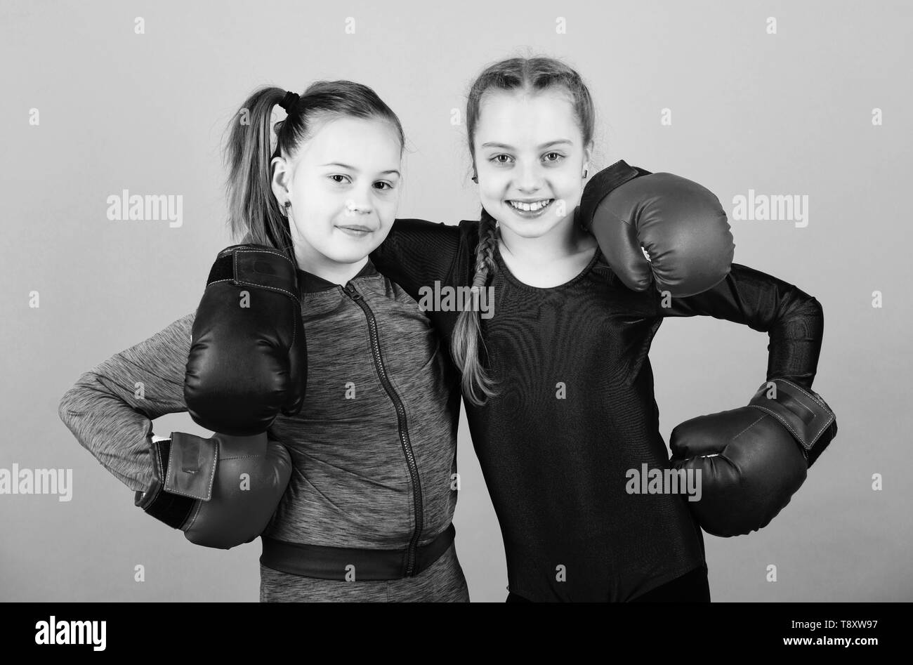 Everything is possible. Happy children sportsman in boxing gloves. workout of small girls boxer in sportswear. punching knockout. Childhood activity. Fitness diet. energy . Sport success. Friendship. - Stock Image