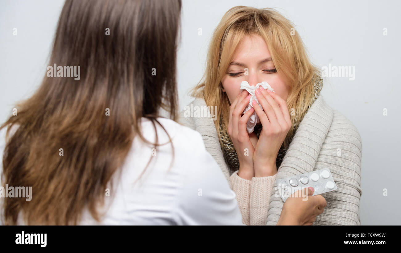 Prescribing medication. Patient care and healthcare. Primary care doctor making diagnosis to sick woman. Medical doctor examining patient. Doctor visiting unhealthy woman at home. - Stock Image