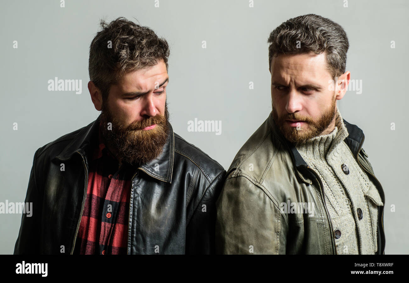 Handsome stylish and cool. Masculine and brutal friends. Bully team. Masculinity and brutality. Feel confident in brutal leather clothes. Brutal men wear leather jackets. Men brutal bearded hipster. - Stock Image
