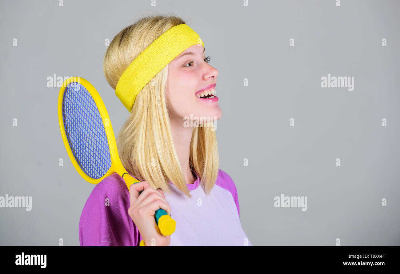 Tennis club concept. Active leisure and hobby. Tennis sport and entertainment. Girl adorable blonde play tennis. Start play game. Sport for maintaining health. Athlete hold tennis racket in hand. - Stock Image