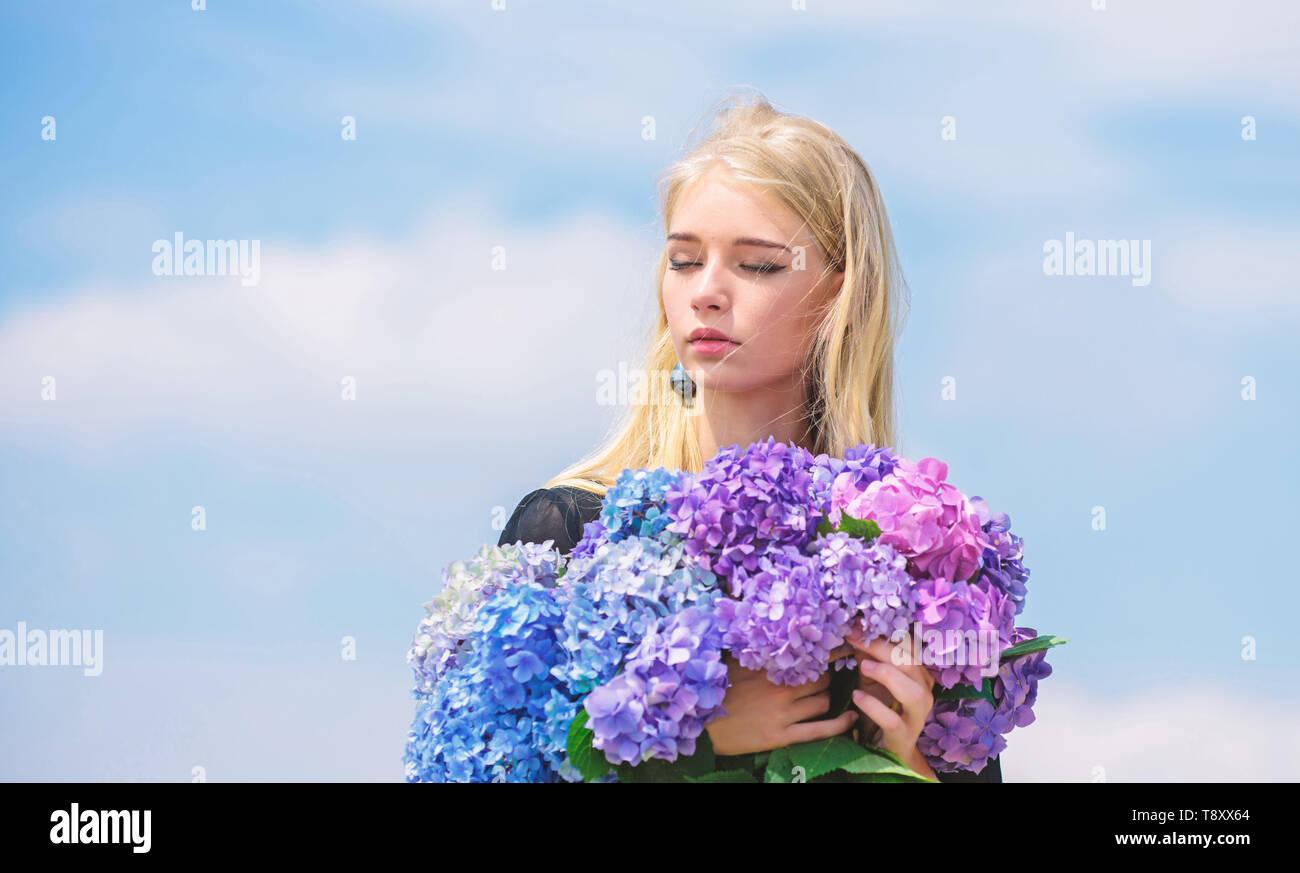 Allergy free life. Stop allergy blooming season. Enjoy spring without allergy. Springtime bloom. Pollen allergy. Gentle flower for delicate woman. Girl tender blonde hold hydrangea flowers bouquet. - Stock Image