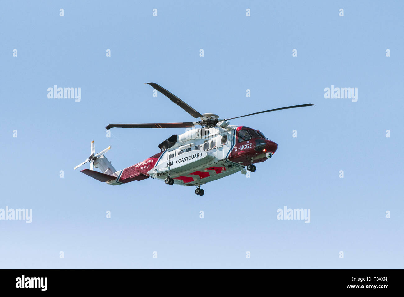 A Sikorsky S-92A HM Coastguard SAR Helicopter G-MCGZ operated by Bristol Helicopters flying overhead on the North Cornwall coast, England, UK. - Stock Image