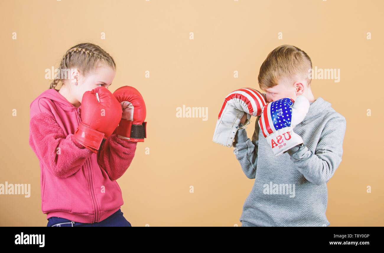 Happy children in boxing gloves. Fitness diet. energy health. punching knockout. activity. Sport success. Friendship fight. workout of small girl and boy boxer in sportswear. Striking the pose. - Stock Image