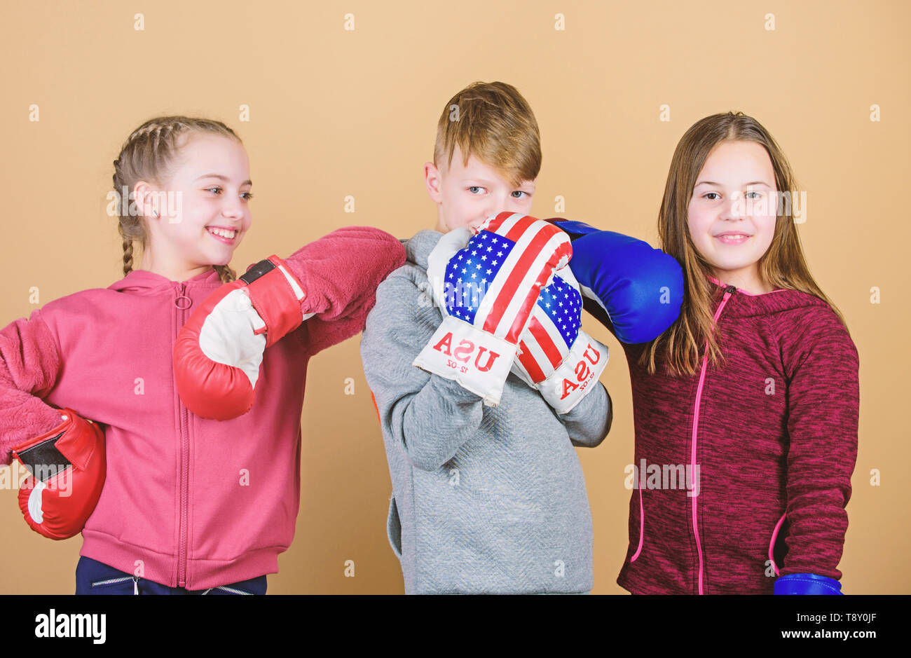 energy health. punching knockout. Childhood activity. Sport success. Team fight. workout of small girls and boy boxer. Happy children in boxing gloves. Fitness diet. Having a little break. - Stock Image