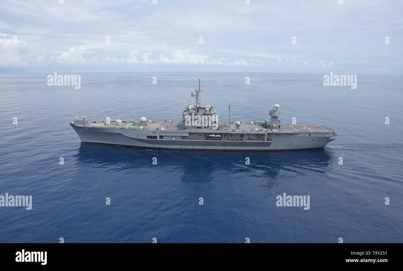 The U.S. Navy Blue Ridge-class amphibious command ship USS Blue Ridge during patrol April 27, 2019 in the South China Sea. - Stock Image