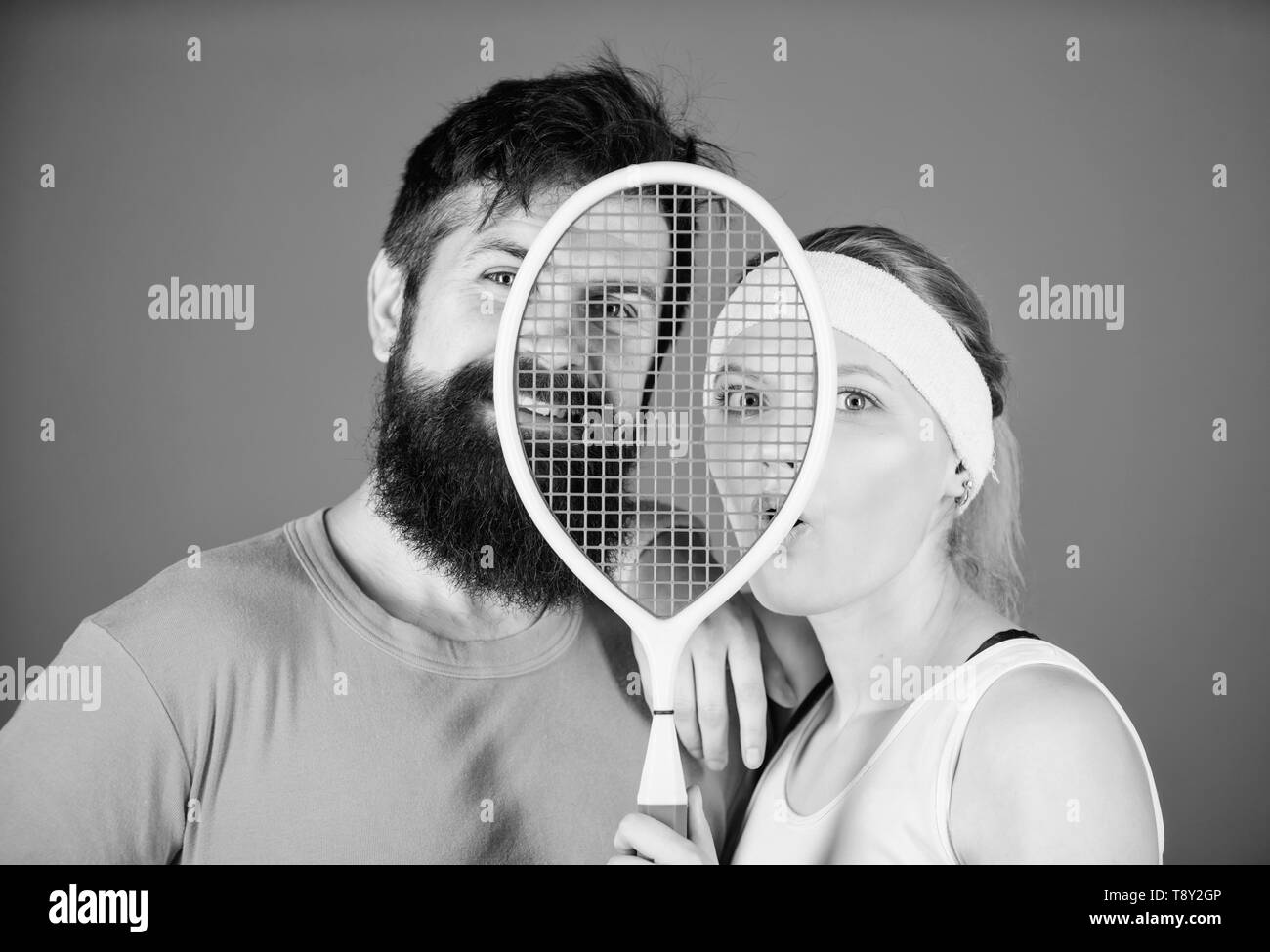 Healthy lifestyle concept. Man and woman couple in love with tennis racket sport equipment. Workout and fitness. Girl and guy play tennis. Couple tennis players. This game is more than hobby. - Stock Image