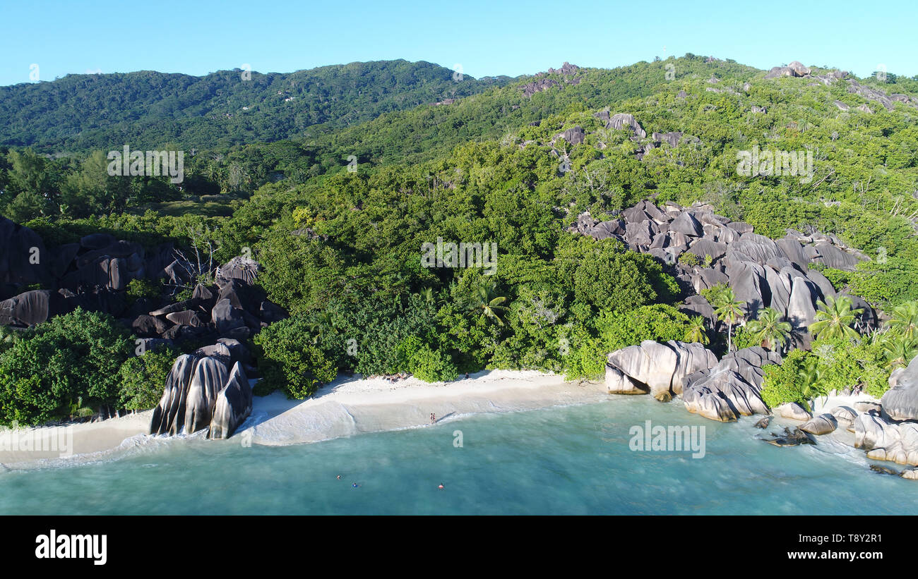 aerial view on anse source d'argent beach on la digue island in seychelles - Stock Image