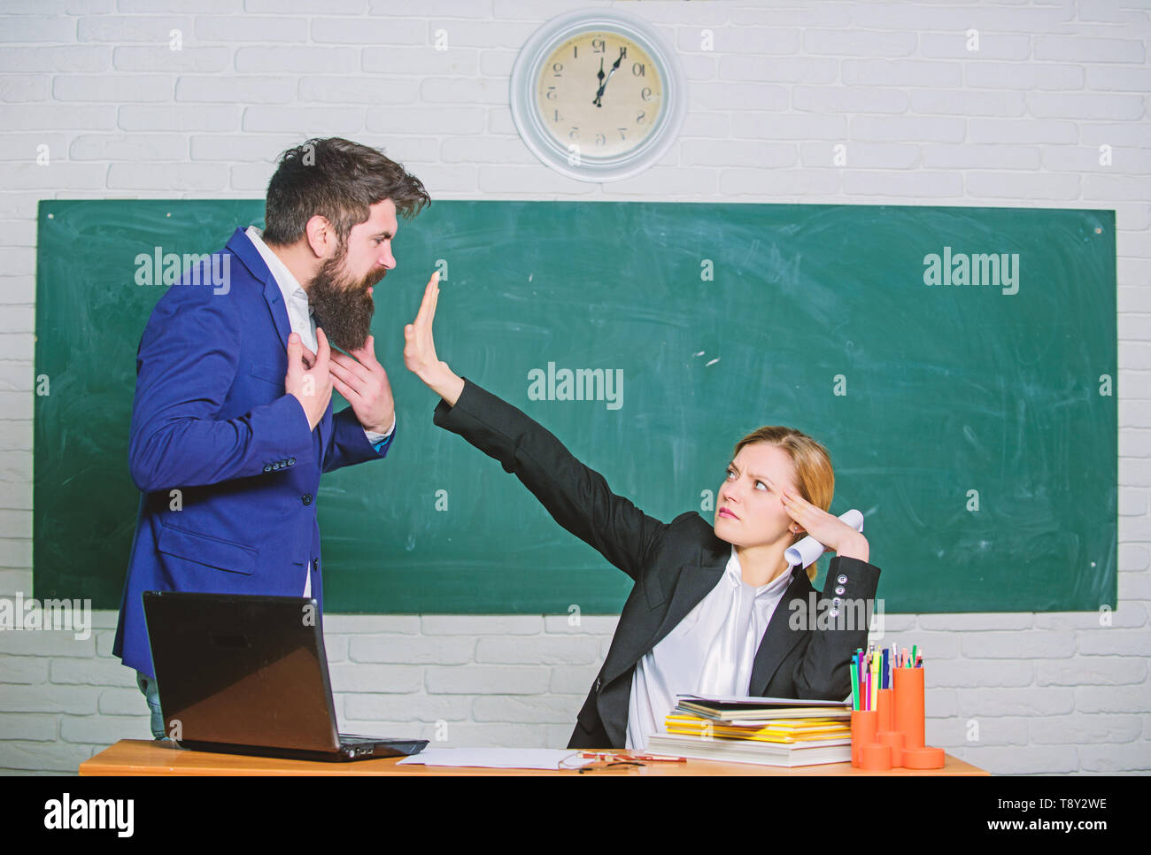 Stop talking to me. Criticism and objection concept. Teacher wants man to shut up. Please shut up. Tired of complaints. Indifferent about objection. Dismissed objection. School teacher and parent. - Stock Image