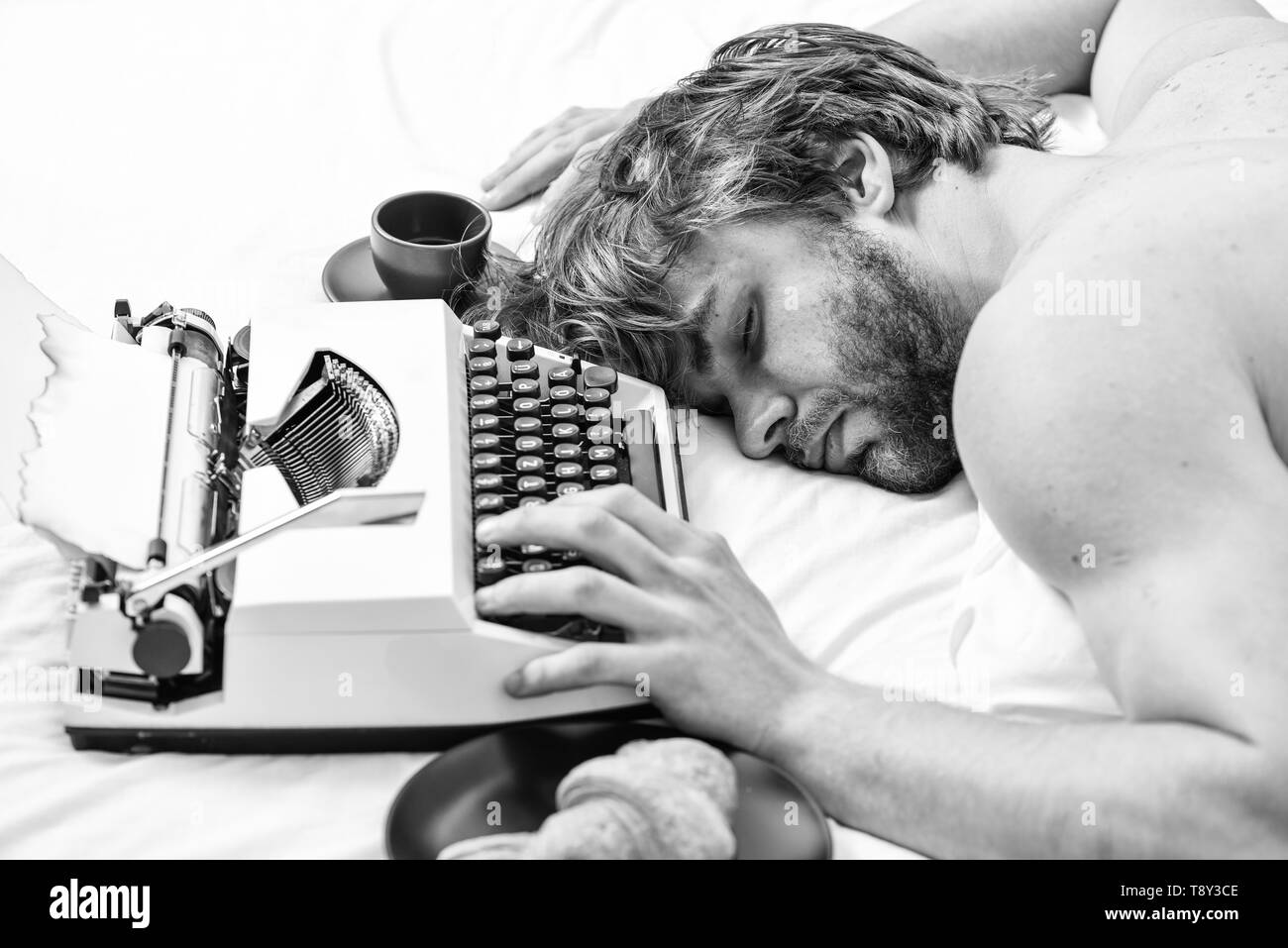 Worked all night. Man fall asleep. Writer used old fashioned typewriter. Author tousled hair fall asleep while write book. Workaholic fall asleep. Man with typewriter sleep. Deadline concept. - Stock Image