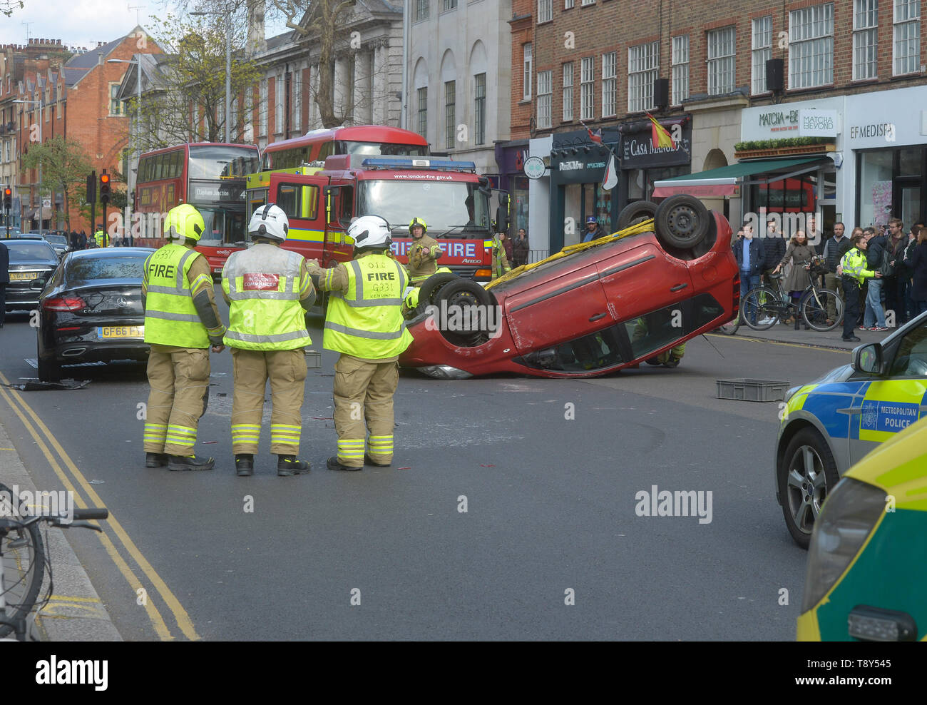 A Car Flips In An Road Traffic Accident On Kings Road In Chelsea Outside The World