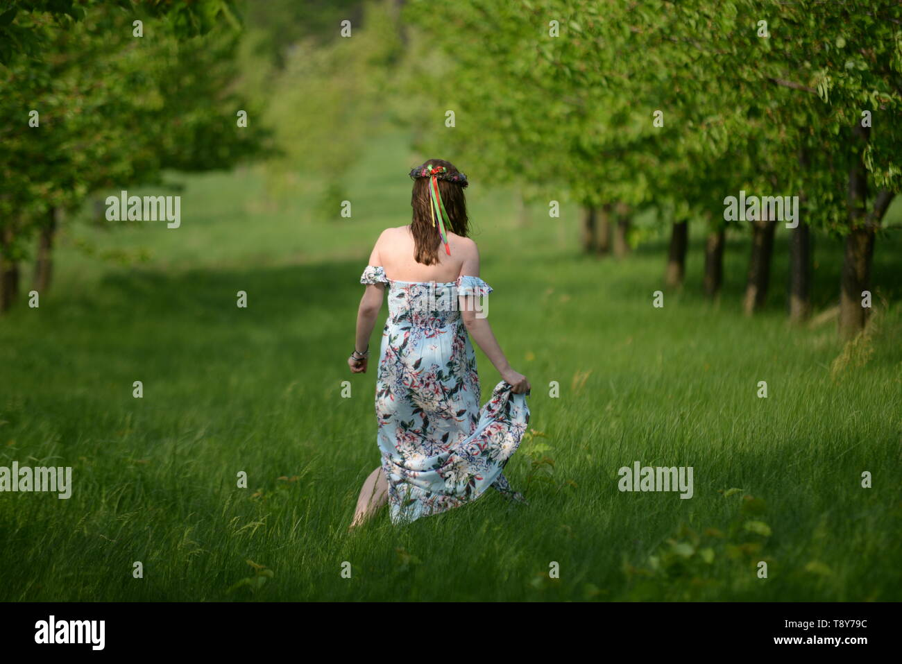 Slavic woman in a fruit garden - Stock Image