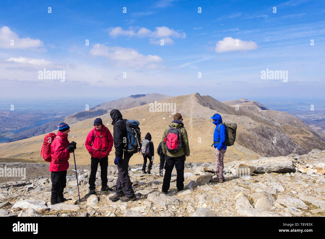 Hikers hiking down Glyder Fawr to Y Garn mountain in mountains of Snowdonia National Park. Ogwen, Gwynedd, Wales, UK, Britain Stock Photo