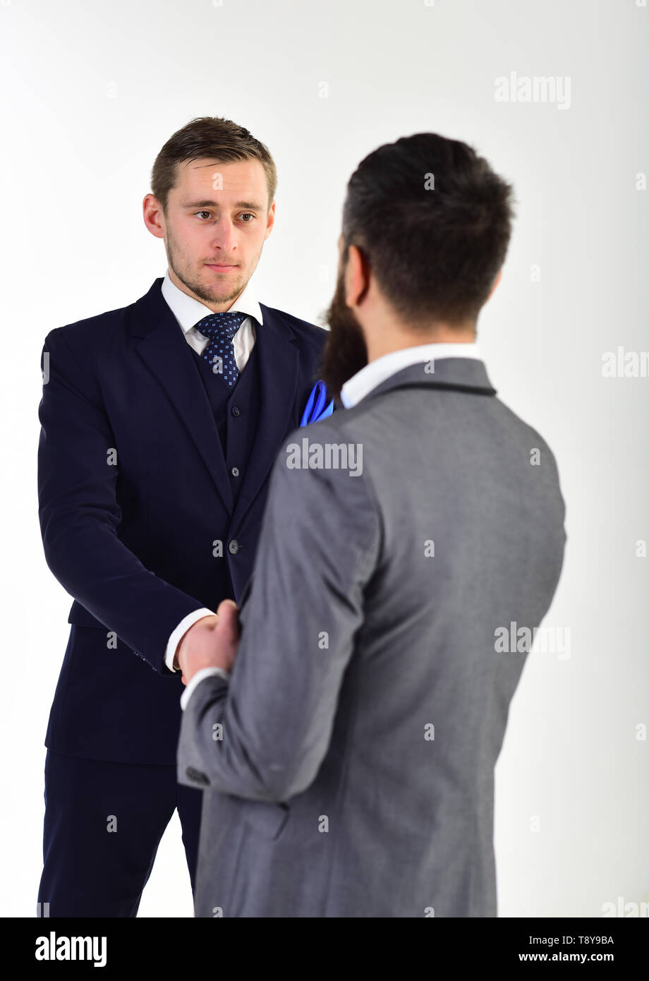 Handshake concept. Businessmen shaking hands, successful deal or acquaintance. Businessmen, business partners meeting, white background. Business - Stock Image