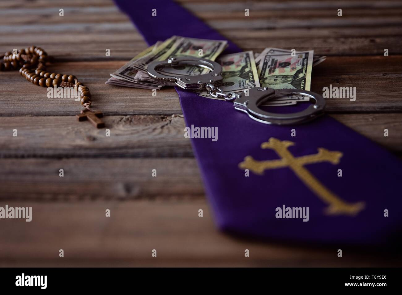 Banknotes and catholic church symbols. Church and money - Stock Image