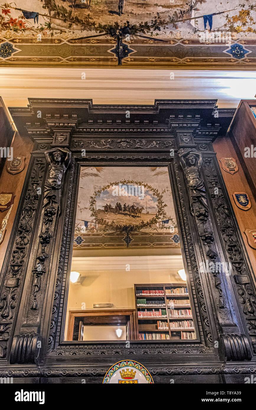 A mirror in an hall of the lhe library of Palazzo Salviati, now home to the Centro Alti Studi della Difesa, in Rome, Italy Stock Photo