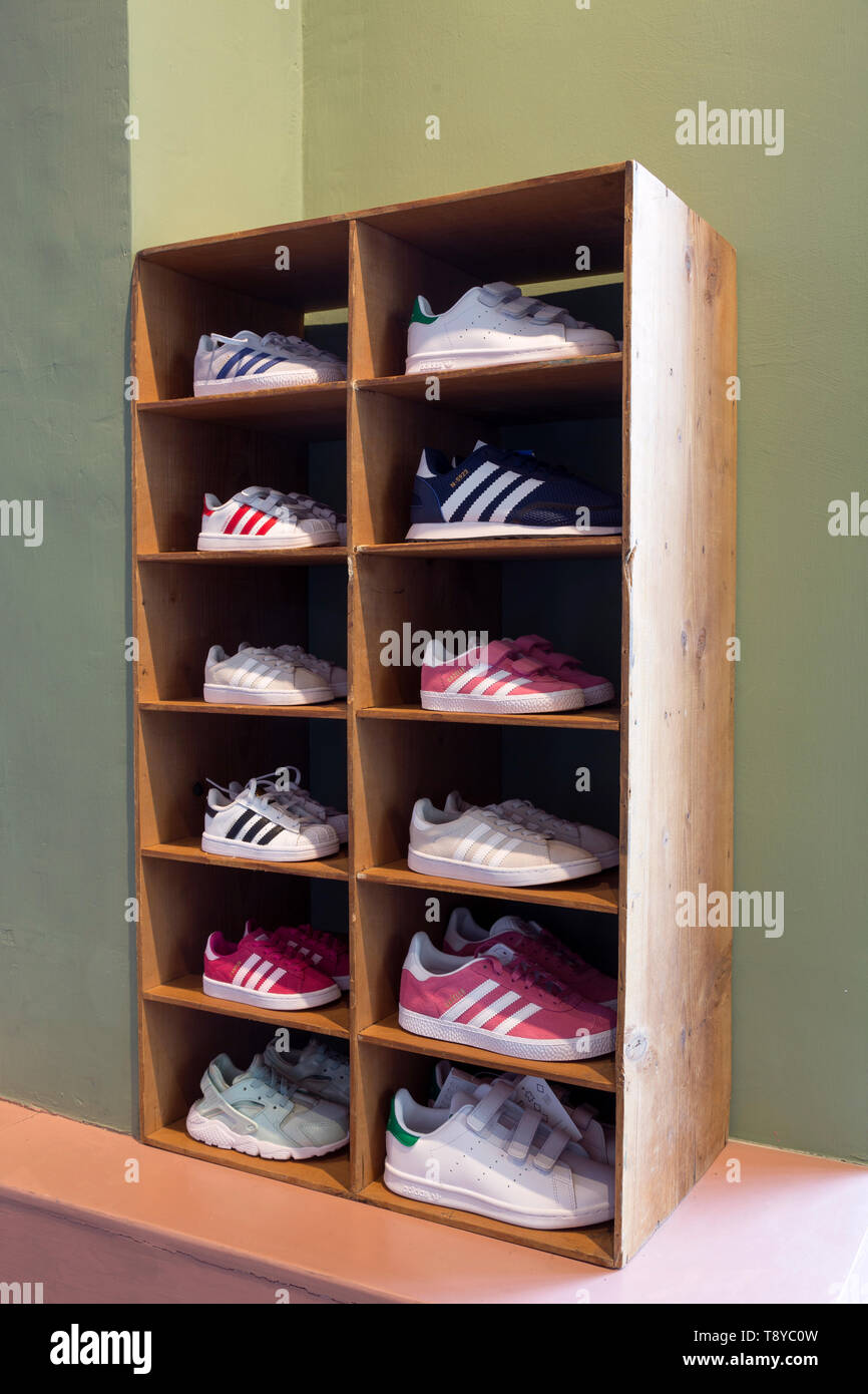 Adidas Sneakers in raw in a display of a store for kids Stock ...