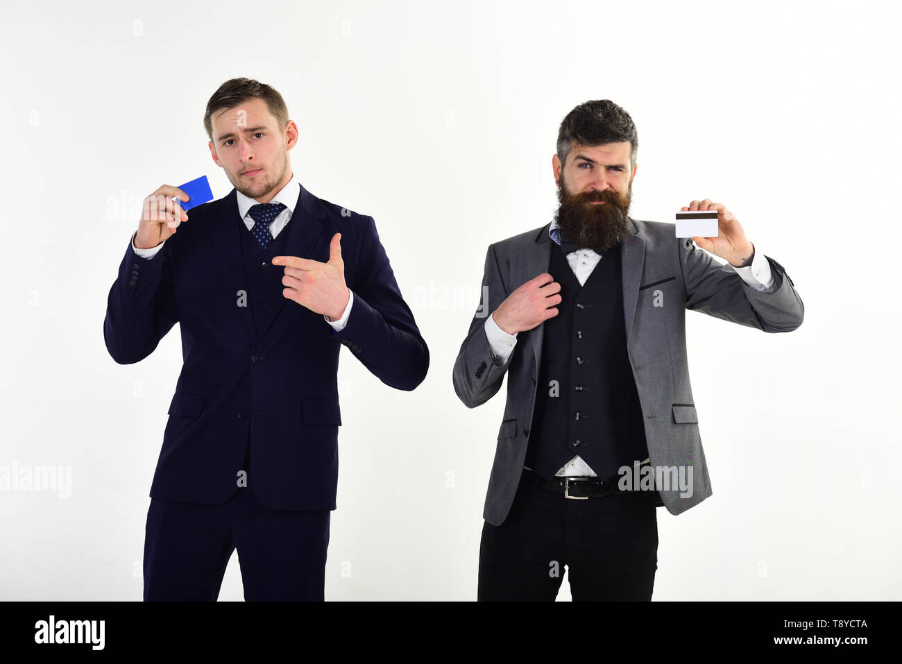 Businessmen hold credit cards. Banker trust in safety and reliability of banking system. Banking concept. Men in formal suit holds plastic cards and - Stock Image