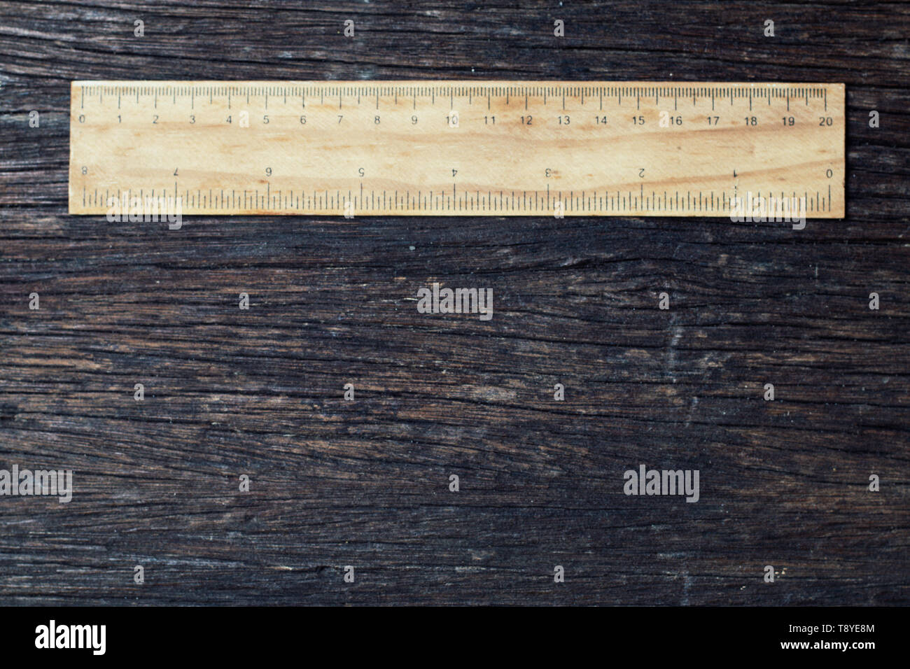 wooden rulers in centimeter and inch on old wood rustic background nature eco environment concept idea - Stock Image