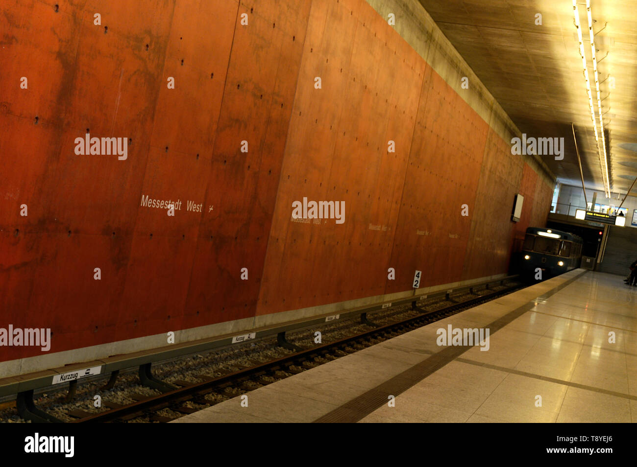 Subway arriving at subway station Messestadt West  in Munich, Germany Stock Photo