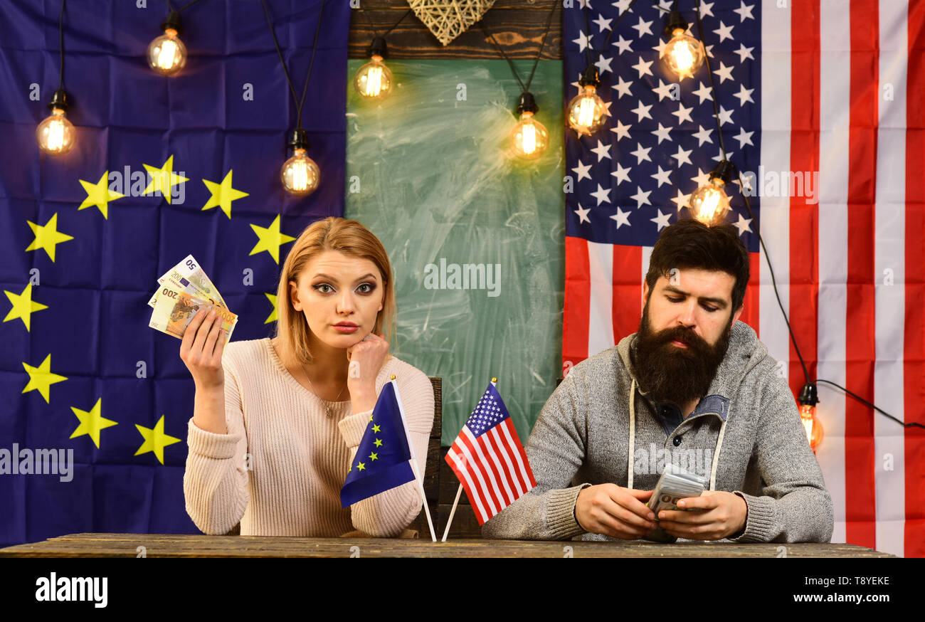 Economic partnership and finance. economic relations of usa and european union with couple holf money. - Stock Image